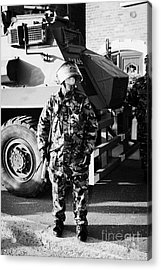 British Army Soldier In Riot Gear With Saxon Armoured Personnel Carrier Vehicle On Crumlin Road At A Acrylic Print by Joe Fox