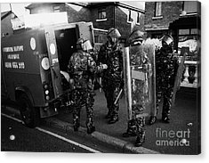British Army Soldiers In Riot Gear Pack Up On Crumlin Road At Ardoyne Shops Belfast 12th July Acrylic Print by Joe Fox