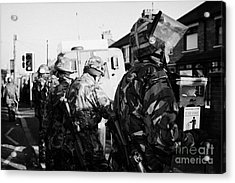 British Army Soldiers In Riot Gear Stand Guard On Crumlin Road At Ardoyne Shops Belfast 12th July Acrylic Print by Joe Fox