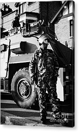 British Army Soldiers In Riot Gear With Saxon Armoured Personnel Carrier Vehicle On Crumlin Road At  Acrylic Print by Joe Fox