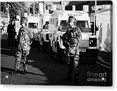 British Army Soldiers With Psni Landrovers On Crumlin Road At Ardoyne Shops Belfast 12th July Acrylic Print by Joe Fox
