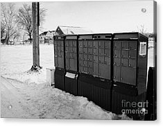 canada post post mailboxes in rural small town Forget Saskatchewan Canada Acrylic Print by Joe Fox