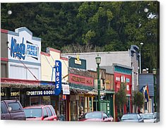 Cars Parked Outside Stores In A City Acrylic Print by Panoramic Images