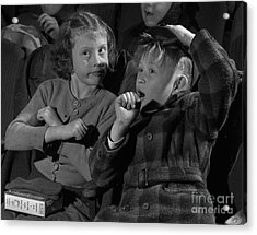 Children At A Film Matinee In 1946 Acrylic Print by The Phillip Harrington Collection