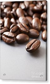 Coffee Beans On Grey Ceramic Surface Acrylic Print by Colin and Linda McKie