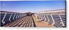 Couple Walking On A Pier, Bay Bridge Acrylic Print by Panoramic Images
