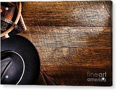 Cowboy Gear On Wood Acrylic Print by Olivier Le Queinec