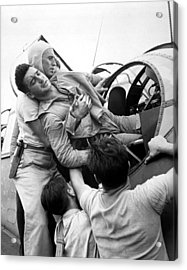 Crewmen Lift A Wounded Pilot Acrylic Print by Everett
