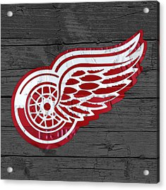 Detroit Red Wings Recycled Vintage Michigan License Plate Fan Art On Distressed Wood Acrylic Print by Design Turnpike