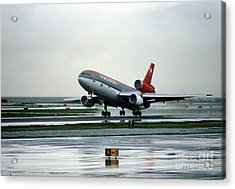 Douglas Dc-10-40 Taking Off In The Rain Acrylic Print by Wernher Krutein