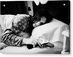 Early Twenties Woman Waking With Hand On Handgun Under Pillow At Night In Bed In A Bedroom Acrylic Print by Joe Fox