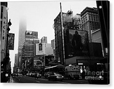 empire state building shrouded in mist from west 34th Street and 7th Avenue new york city usa Acrylic Print by Joe Fox