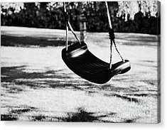 Empty Plastic Swing Swinging In A Garden In The Evening Acrylic Print by Joe Fox