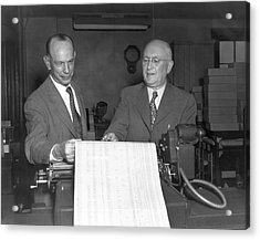 Executives Viewing Data Sheets Acrylic Print by Underwood Archives