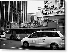 Gray Line New York Sightseeing Bus And Yellow Mpv Taxi Cab On 7th Avenue New York City Acrylic Print by Joe Fox
