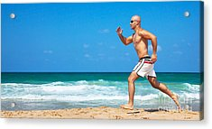 Healthy Man Running On The Beach Acrylic Print by Anna Omelchenko