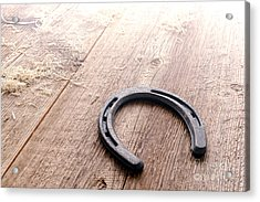 Horseshoe On Wood Floor Acrylic Print by Olivier Le Queinec