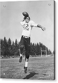 Joe Francis Throwing Football Acrylic Print by Underwood Archives