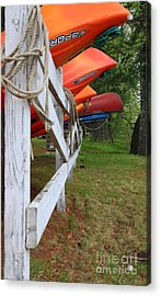 Kayaks On A Fence Acrylic Print by Michael Mooney