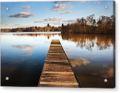 Landscape Of Fishing Jetty On Calm Lake At Sunset With Reflectio Acrylic Print by Matthew Gibson
