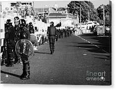 Line Of Psni Officers And Land Rovers In Riot Gear On Crumlin Road At Ardoyne Shops Belfast 12th Jul Acrylic Print by Joe Fox