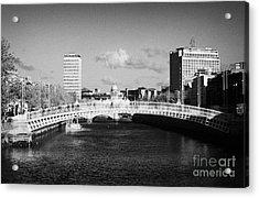 Looking Down The Liffey Towards The Hapenny Ha Penny Bridge Over The River Liffey In Dublin Acrylic Print by Joe Fox