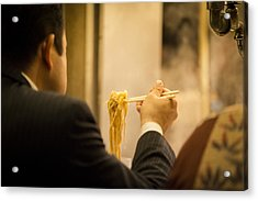 Man Eating Noodles In A Restaurant Acrylic Print by Ruben Vicente