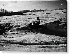 man on snowmobile crossing frozen fields in rural Forget Saskatchewan Canada Acrylic Print by Joe Fox