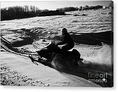 man on snowmobile crossing frozen fields in rural Forget Saskatchewan Acrylic Print by Joe Fox