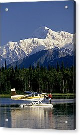 Man Spin Fishing On Lake From Acrylic Print by Jeff Schultz