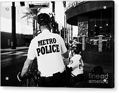 metro police bicycle cops in downtown Las Vegas Nevada USA Acrylic Print by Joe Fox