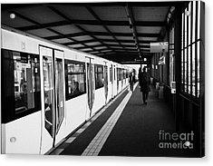 modern yellow u-bahn train sitting at station platform Berlin Germany Acrylic Print by Joe Fox