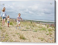 Mother And Children On Beach Acrylic Print by Ian Hooton