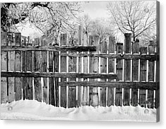 old patched up wooden fence using old bits of wood in snow Forget Saskatchewan Canada Acrylic Print by Joe Fox