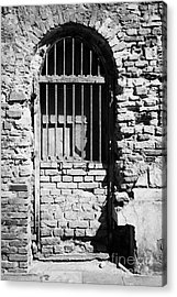 Old Wooden Framed Window With Weathered Steel Bars Door Replacement In Red Brick Building With Plaster Removed Krakow Acrylic Print by Joe Fox