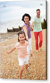 Parents Running On Beach With Daughter Acrylic Print by Ian Hooton