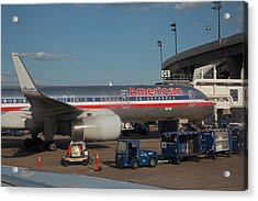 Passenger Airliner At An Airport Acrylic Print by Jim West
