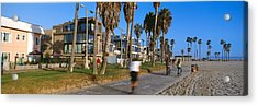 People Riding Bicycles Near A Beach Acrylic Print by Panoramic Images