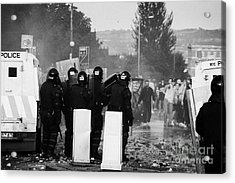 Police Officers In Riot Gear Face Rioters On Crumlin Road At Ardoyne Acrylic Print by Joe Fox