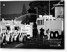 Psni Armoured Land Rovers And Water Canon On Crumlin Road At Ardoyne Shops Belfast 12th July Acrylic Print by Joe Fox