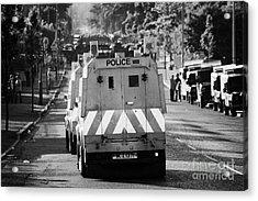 Psni Land Rovers Head Up The Crumlin Road Towards Loyalists At Ardoyne Shops Belfast 12th July Acrylic Print by Joe Fox