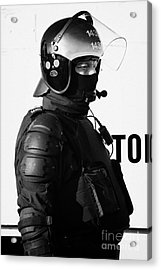 Psni Officer In Ninja Riot Geat On Crumlin Road At Ardoyne Shops Belfast 12th July Acrylic Print by Joe Fox
