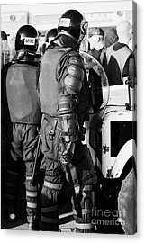 Psni Officer In Riot Gear With Shield And Baton On Crumlin Road At Ardoyne Shops Belfast 12th July Acrylic Print by Joe Fox