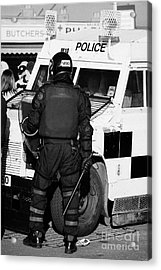 Psni Officer With Riot Gear And Baton In Front Of Land Rover On Crumlin Road At Ardoyne Shops Belfas Acrylic Print by Joe Fox