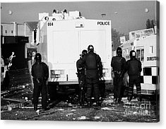 Psni Officers Behind Water Canon During Riot On Crumlin Road At Ardoyne Shops Belfast 12th July Acrylic Print by Joe Fox