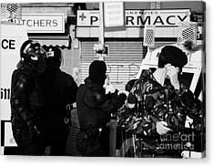 Psni Riot Officers And British Soldier On Crumlin Road At Ardoyne Shops Belfast 12th July Acrylic Print by Joe Fox