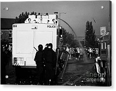 Psni Riot Officers Behind Water Canon During Rioting On Crumlin Road At Ardoyne Acrylic Print by Joe Fox