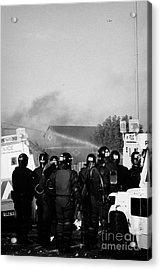 Psni Riot Officers Watch Rioting On Crumlin Road At Ardoyne Shops Belfast 12th July Acrylic Print by Joe Fox