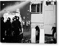 Psni Riot Police Behind Armoured Land Rover And Water Canon Face On Crumlin Road At Ardoyne Acrylic Print by Joe Fox