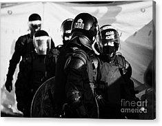 Psni Riot Squad Officers On Crumlin Road At Ardoyne Shops Belfast 12th July Acrylic Print by Joe Fox